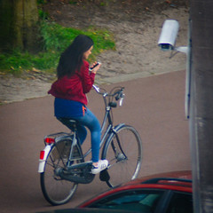 An Important Message (Arthur Koek) Tags: girl longhair cycling bicycle smartphone adidas sneakers harderwijk veluwe gelderland thenetherlands