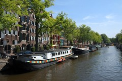 Houseboats On Amsterdam's Prinsengracht (the Prince's Canal) (elhawk) Tags: amsterdam warehouses canal houseboat