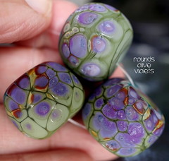 Rounds Olive Violets (Laura Blanck Openstudio) Tags: openstudio openstudiobeads set jewelry glass handmade lampwork beads bead murano opaque matte frosted glow etched whimsical funky odd round donut abstract asymmetric organic earthy colorful multicolor speckles made usa raku frit artisan artist fine arts art kiln annealed grape plum mauve lilac lavender violet purple olive green ocher copper