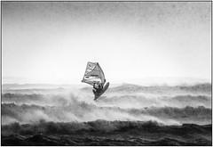 Windsurfing the Storm (glenn porter) Tags: windsurfing storm sea wales rain windsurf black white mono monochrome rough seas gale