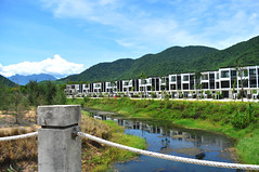Resort apartments (Roving I) Tags: apartments architecture resorts lifestyle leisure golf laguna langco luxury bridges ropes rivers canals hills greenery cloud water reflections travel tourism vietnam
