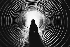 through the tunnel (L. Paul) Tags: blackandwhite tunnel boy son sonya6300 sony28mmf2
