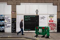 Bad Seeds (stevedexteruk) Tags: polandstreet graffiti street art barrier pavement man walking soho london uk metro hoarding construction nick cave bad seeds billboard