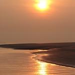 "zandbank_met_zonsondergang <a style=""margin-left:10px; font-size:0.8em;"" href=""http://www.flickr.com/photos/117161355@N07/15602347693/"" target=""_blank"">@flickr</a>"