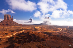Fog on the mittens (doveoggi) Tags: park morning red arizona fog desert monumentvalley 2047