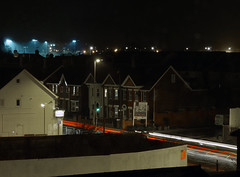 night light trails (dawn.v) Tags: road uk england urban window night town january stormy dorset lighttrails poole afterdark stormyweather throughmywindow hamworthy nightscenerymode blandfordroad lumixtz25