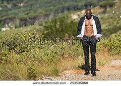 stock-photo-african-black-male-model-wearing-black-suit-with-white-unbuttoned-shirt-standing-on-gravel-path-253535068 (Soft Focus Photography) Tags: road white mountain man black sexy male men fashion businessman shirt modern standing dark walking person model open looking adult body path walk african background coat young formal handsome style professional business suit pack tuxedo american topless attractive elegant six toned success isolated unbuttoned gravel confident stylish