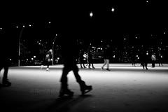 Ghost Skaters 6 (LongInt57) Tags: girls people bw woman white canada man motion black blur men ice boys fun person grey lights mono women shadows bc action okanagan skating gray teens silhoettes skaters rink recreation kelowna wintertime skates