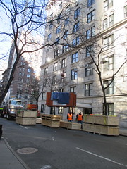 Crane Delivery Loading on 65th Street NYC 3911 (Brechtbug) Tags: park street new york city nyc urban orange window crane near manhattan side front storage september east container midtown delivery hanging avenue shipping crate loading lifting 65th 2015 01172015