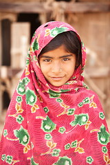 Cholistani Girl (Awais Yaqub) Tags: pakistan red portrait girl smile desert shawl cholistan