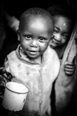 Street boy (Victoria de Bonilla) Tags: poverty africa street boy bw 50mm calle kenya bn nio kenia pobreza