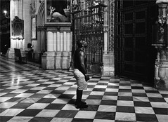 don't we all believe ? (zilverbat.) Tags: spanje church zilverbat blackwhitephotos zwartwit blackandwhite monochrome bw people portrait portret streetphotography candid canon streetcandid negro peopleinthecity noir blanco man indoor floor surpriced