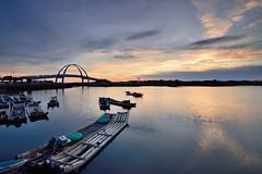 Wang Kung fishing port (Vincent_Ting) Tags:    taiwan fishingport sunset reflection cloudscape    wharf  archbridge vincentting sky sea