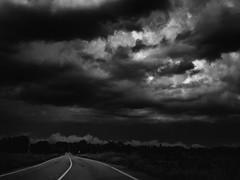 Undir berum himni (Lumase) Tags: clouds storm stormysky overcast ominous road driving monochrome bw countryside landscape beautyinnature