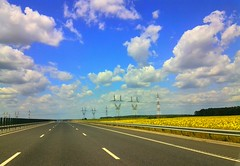 Clouds over the highway (Sergiu St. O.) Tags: clouds highway sunflower prahovacounty romania