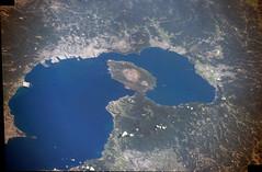The Making of a Salt Lake in Southern Kyushu (but not yet) (sjrankin) Tags: 1september2016 edited japan nasa iss iss048 iss048e64624 iss048e64625 kagoshima volcano sakurajima bay kagoshimabay kyushu large 1092mb