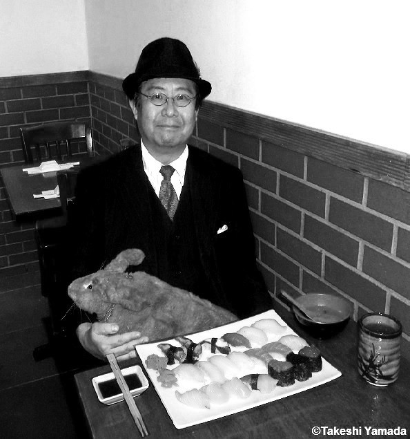 Dr. Takeshi Yamada and Seara (sea rabbit) at the Sake Japanese restaurant in Brooklyn, New York on October 8, 2014. It is one of their favorite restaurants in New York City. Sushi. 20141008 070=C2BW area contrast enhancement