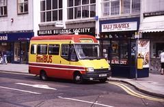 School Street, Wolverhampton, 1987 (Lady Wulfrun) Tags: street school red 3 bus 1st 1987 august route service shelter midland abacus minibus wolverhampton fordtransit schoolstreet midlandred halifaxbuildingsociety chaserider d90cfa balutravels