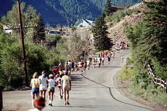 3e-065 (ndpa / s. lundeen, archivist) Tags: road houses homes summer people mountains color film race 35mm centennial colorado nick july running powerlines runners rockymountains aspen july4th 4thofjuly runner 1980 1980s utilitypole 100thbirthday dewolf 3e splitrailfence nickdewolf photographbynickdewolf 18801980 fivemilerace aspenglo reel3e aspencentennial aspenglofive