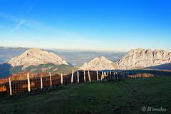 Urkiola mountains at sunset (Mimadeo) Tags: sunlight mountain mountains grass rock fence landscape spain top rocky peak sunny basque euskadi basquecountry paisvasco mountainrange urkiola