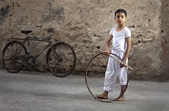 Ring game (ali darwish233) Tags: road lighting old people game heritage bicycle canon photo child play ring arab علي زمان لعبة photogarpher تراث شعبية قديمة درويش مصور أضاءة alidarwish