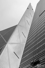 Ants to Ants (Tim van Zundert) Tags: china white black tower window glass monochrome architecture skyscraper buildings island angle steel sony cleaners central bank hong kong 2470 a7r sel2470z