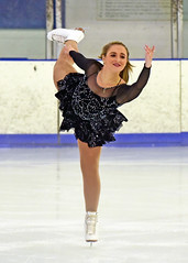 Skater in Black-n-Silver 2 (R.A. Killmer) Tags: skill smile skate skater ice beauty performer performance blades fast glide spin jump form pretty precision