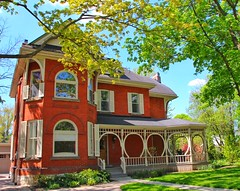 Stratford Ontario ~ Canada  ~ Architecture Heritage (Onasill ~ Bill Badzo) Tags: on ontario perthcounty stratford architectureheritage architecture historic victorian queen anne style north america rounded porch eastlake romanesque red brick reflections waking tour onasill
