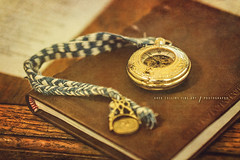 Golden Timepiece (Greg Collins Fine Art) Tags: reenactment colonial colony ftfrederick frederick fort war battle revolution revolutionary america timepiece watch pocketwatch gold golden lanyard paper book leather gear gears number numbers table wood