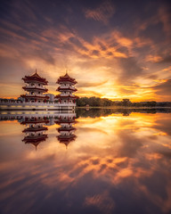 Oriental Glory (Scintt) Tags: singapore chinese garden landscape water reflection mirror symmetry epic surreal light glow sunset sun sky clouds evening yellow orange golden colours pagoda oriental travel tourism exploration lake pond vast jon chiang photography scintillation scintt