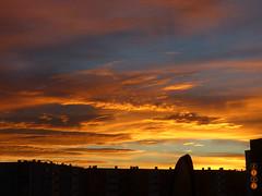 sunset sky (Ryuu) Tags: sunset sky orange clouds golden cloud gold heaven yellow skyscape settingsun sundown fiery cloudy heavenly nature view horizon buildings dark silhouettes city highpov perspective skyscrapers silhouette urban light blue red fz200 evening dusk