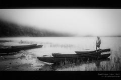 Canoe boy (= A r r a y =) Tags: bali tamblingan flektogon lake monochrome