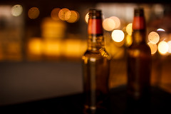 Blurred Bottles And Bokeh (thethomsn) Tags: blurred bottles bokeh gold outoffocus night 30mm experimental lights lowlight soft thethomsn sigma