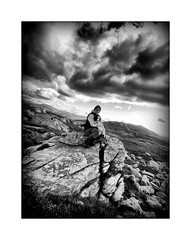 A Rock with a view! (Missy Jussy) Tags: rocks man dog sky clouds hills nationalpark view scenery walkinglandscape landscape lane light sunlight trevorkerr frame mono monochrome bw blackwhite canon canonpowershotsx60 rupert rupertbear