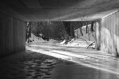 River Tunnel Shadows : Iced Over (Abandoned Illinois) Tags: winter light sunset sky blackandwhite bw sun black ice set river foot shine bright over tunnel step footsteps whit iced rise