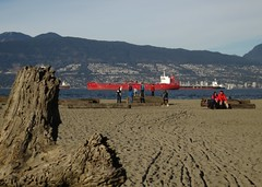 February weekend at Jericho (Ruth and Dave) Tags: people mountains beach weather vancouver coast seaside log sand warm ship sitting sandy sunny driftwood englishbay february containership jerichobeach