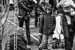 """""""boy and beggar"""" -homeless beggar at Columbia Road Flower - Market IMG_2569-Edit (roger_thelwell) Tags: life road street city uk winter portrait england people urban bw white black streets cold flower london lamp monochrome beautiful westminster beauty hat rain leather mobile umbrella hair bag walking real photography mono chat shiny phone traffic post natural market photos britain circus cigarette candid cab taxi homeless great over sac hats cell columbia photographic smoking beggar lamppost photographs oxford conversation shiney talking shoulder handbag stud speak speaking studs commuters stylish stunningly scak boyandbeggar"""