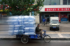 Commerce - Chinese Culligan Man To Market 2 (Don Thoreby) Tags: life china man sign truck living commerce transport banner chinese daily silkroad trike overloaded waterdelivery culligan tomarket waterjugs culliganman cargotrike chinasilkroad