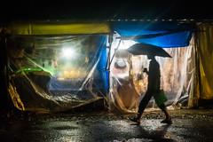 Monsoon | Street of Murudheswar,India. (vjisin) Tags: india murudeshwar karnataka konkancoast coast monsoon asia lights nikond3200 nikon nikonofficial nikonindia indiantourism cwc chennaiweekendclickers cwc534 outdoor water complementarycolours yellow blue nightphotography nightlights umbrella indianman framed man