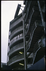 The Other...... (thenorthernmonkey77) Tags: yashica electro gsn film fuji superior 200iso vintagecamera filmcamera filmsnotdead shootfilm wellington newzealand nz carpark building architecture grey concrete 1960s graffiti stairs staircase multistory rangefinder