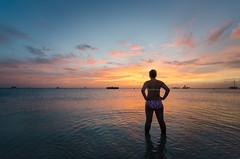 My wife watching the Aruba sunset. (henry_g87) Tags: nikon d7000 tokina tokinaaf1116mmf28 wideangle mode aruba palmbeach sky clouds sunset seaside outdoor ocean water
