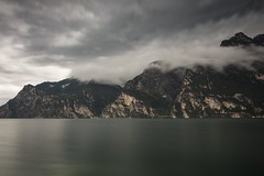 The calm before the storm (Rimon01) Tags: storm calm long exposure smooth water clouds dark light lago di garda riva del torbole river ponale rolling up darkness nikon d7200 18105vr 18105mm nature landscape thunderstorm thunder valley towns weather rain raining storming