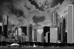 Chicago skyline (mariola aga) Tags: chicago downtown skyscrapers buildings architecture lakemichigan lake shoreline sky clouds bw black white monochrome thegalaxy