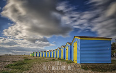 Blue & Yellow. (Emily_Endean_Photography) Tags: littlehampton beach beachhuts sunny coast sussex clouds longexposure lee leefilters bigstopper nikon