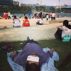 Luncheon on the grass 3. (zeoger) Tags: pinic handphone mobile sleep nap park landscape suburban fakebeach changsha china asia architecture city