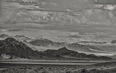 nothing but desert... (Alvin Harp) Tags: desert mojavedesert zyzzxrd zyzzx california october 2015 nature naturesbeauty monochrome bw blackandwhite highkey clouds mountains travels remote sonyilce7rm2 fe24240mm alvinharp