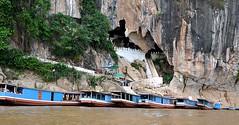 tourist boats lined up at PakOu caves (davidparratt) Tags: river boat cave laos mekong pakoucaves