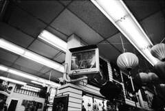 Surveillance In Chinatown Gift Shop (nico.padayhag) Tags: sf street people blackandwhite bw film st 35mm dark photography san francisco chinatown locals photos grain documentary location study stockton based kodaktmax nicopadayhag iford500