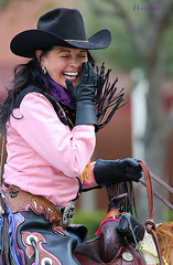 Cowgirl  Laughs (wyojones) Tags: horse woman cute girl beautiful smile hat shirt mouth hair belt pretty texas coat houston parade gloves laugh earrings cowgirl brunette lovely bandana chaps horseback beltbuckle carin houstonlivestockshowandrodeo reins cowgirlhat saddlehorn crinklednose cellphonecase valleylodgetrailride wyojones houstonlivestockshowandrodeoparade