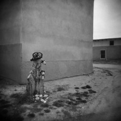 Truchas #1 (LowerDarnley) Tags: holga truchas newmexico southwest adobe houses empty lights treestump